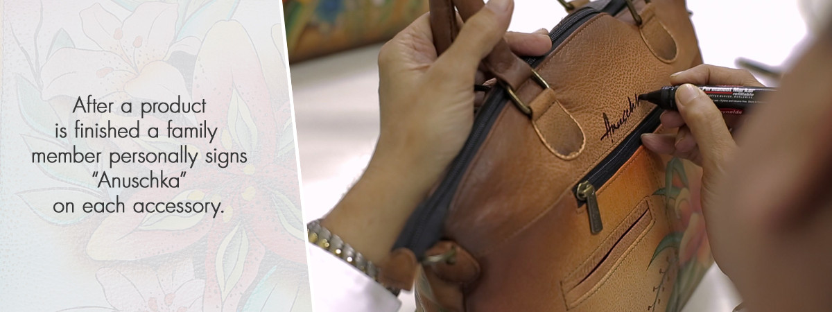 Trained artisans sketch each piece before painting the entire bag with original Anuschka art.