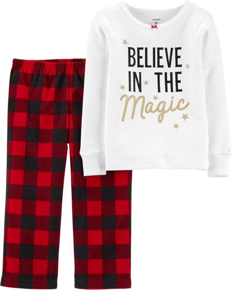 Christmas pajamas for toddlers with buffalo plaid pants and a shirt that says believe in the magic